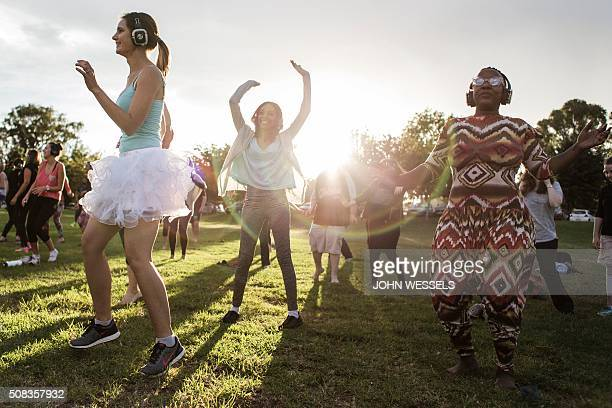 Participants at the Secret Sun Rise event dance with about 300 others in the early hours of the morning on February 04 2016 in Johannesburg South...