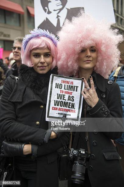 Participants at the Women's March in New York City 21st January 2017 They are wearing pink wigs and holding a sign with a quote from former First...