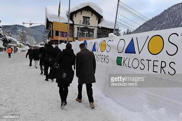 Participants at the World Economic Forum arrive on January 26 2012 at the congress center of the Swiss resort of Davos Over four decades the annual...