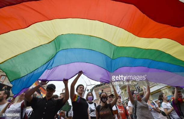 Participants attend a gay pride march in central Kiev on June 17 2018 Several thousand people took part in Kiev's gay pride event amid a heavy police...