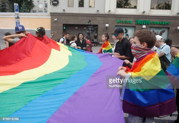 Participants attend a gay pride march in Kiev Ukraine 17 June 2018 Several thousand people have taken part in Kiev's gay pride event amid a heavy...