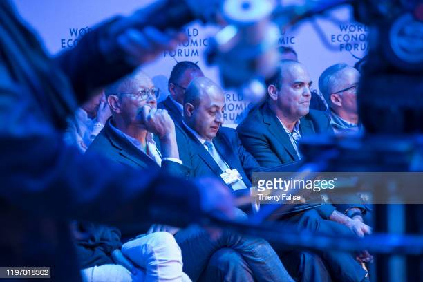 Participants attend a panel at the 50th World Economic Forum in Davos