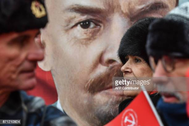 Participants attend a rally marking the 100th anniversary of the 1917 Bolshevik Revolution in downtown Moscow on November 7 2017 / AFP PHOTO / Yuri...