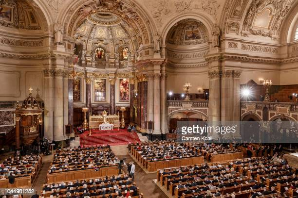 Participants attend a service at the Dom cathedral during celebrations to mark German Unity Day on October 3 2018 in Berlin Germany Unity Day a...