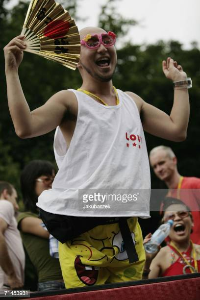 """Participants attend at the """"Loveparade"""" on July 15 in Berlin, Germany. Over 300 DJs on 39 trucks, so called """"floats"""" turn the street """"Strasse des 17...."""