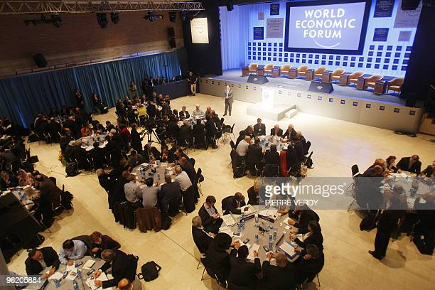 Participants attend the '2008 World Economic Brainstorming Addressing Uncertainly' roundtable discussions at the congress center in davos 23 January...