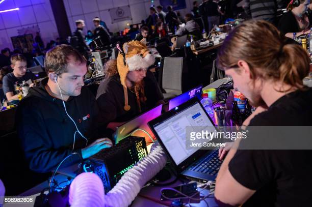 Participants attend the 34C3 Chaos Communication Congress of the Chaos Computer Club on December 27 2017 in Leipzig Germany The annual congress...
