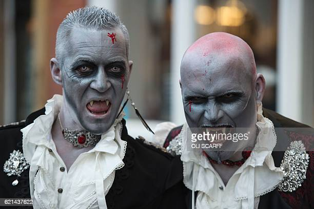 Participants attend the biannual 'Whitby Goth Weekend' festival in Whitby northern England on November 6 2016 The festival brings together thousands...