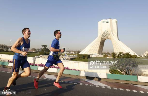 TOPSHOT Participants attend the first international Tehran marathon at Azadi Square in Tehran on April 7 2017 Americans are among runners from more...