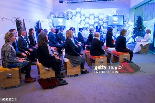 Participants attend the morning meditation session at the annual World Economic Forum on January 24 2018 in Davos eastern Switzerland / AFP PHOTO /...