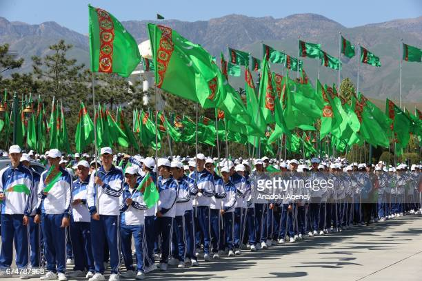 Participants attend the opening ceremony of AkhalTeke Horse Beauty Contest within annual Turkmen Racing Horse Festival in Ashgabat Turkmenistan on...