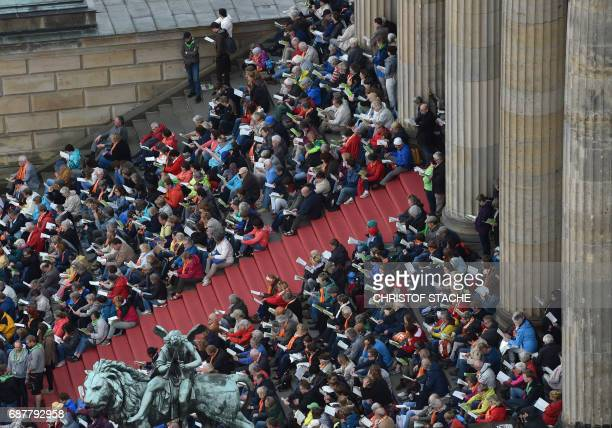 Participants attend the opening mass of the Kirchentag festival celebrating the 500th anniversary of the Reformation in Berlin Germany on May 24 2017...