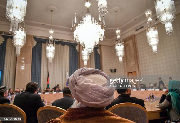 Participants attend the opening of the twoday talks of the Taliban and Afghan opposition representatives at the President Hotel in Moscow on February...