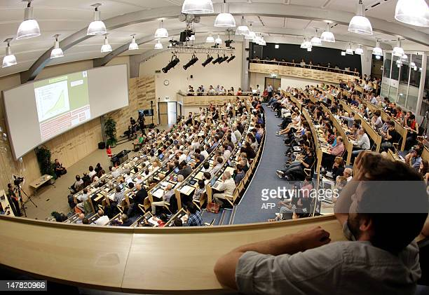 Participants attend the presentation of the ATLAS experiments results on July 4 2012 during a seminar on the latest update in the 50year bid to...