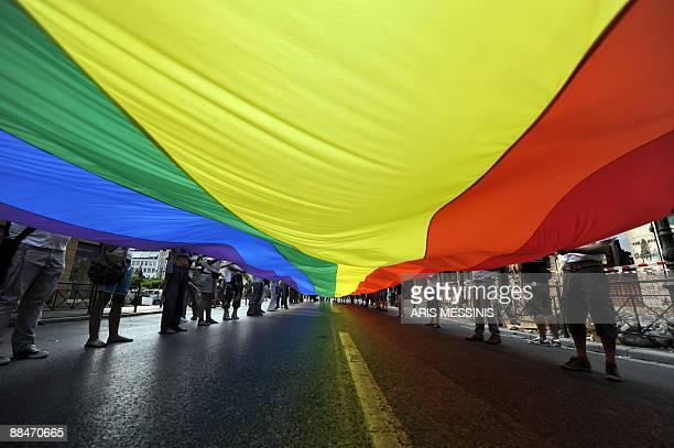Participants attends the 2009 Athens Gay Pride on June 13 2009 AFP PHOTO / Aris Messinis