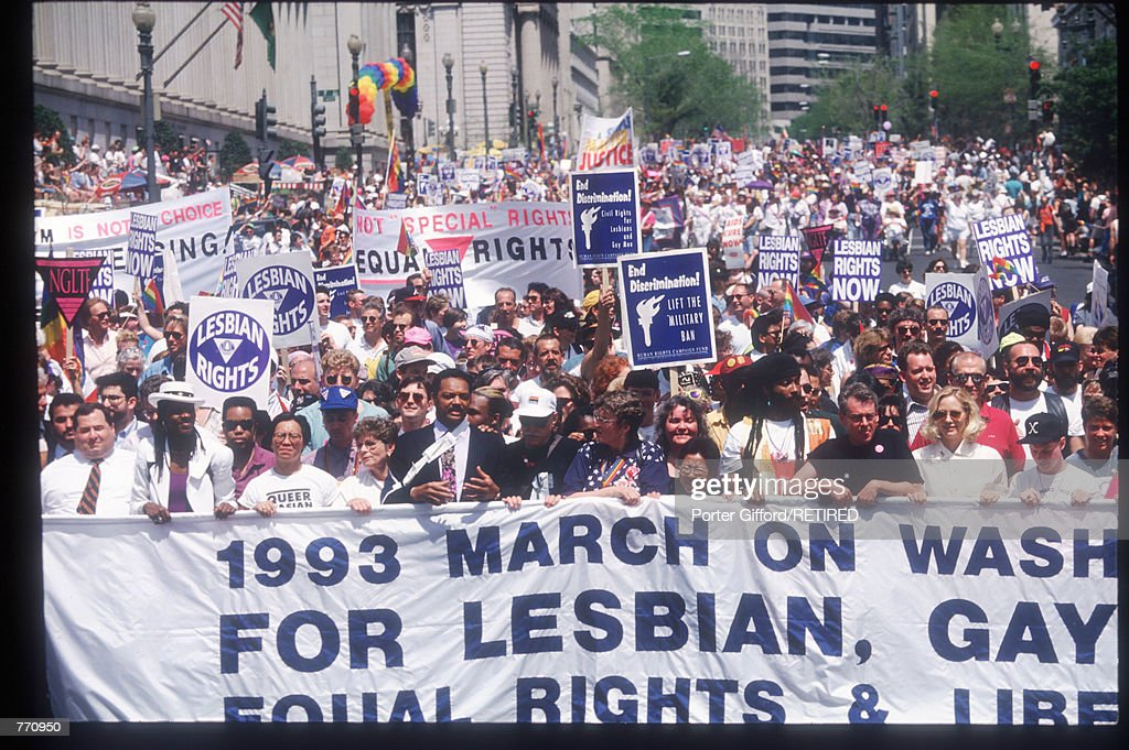 Participants carry a banner during the Gay Rights March April 25, 1993 in Washington, DC. Over 500,000 gays, lesbians and bisexual activists and their friends and families participated in the largest gathering of gay men and lesbians in history organized to end discrimination.