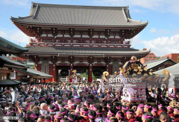Participants carry a mikoshi near Asakusa Temple on the third and final day of Sanja Festival on May 20 2018 in Tokyo Japan Sanja Festival is held...