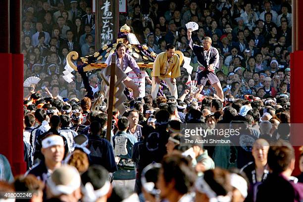 Participants carry a portable shrine during the annual Sanja Festival at Sensoji Temple on May 20 2007 in Tokyo Japan