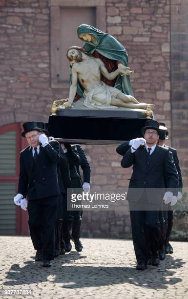 Participants carry an effigy of Jesus Christ during the annual Palm Sunday procession on March 25 2018 in Heiligenstadt Germany The annual event...
