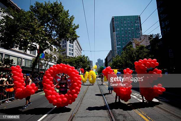 """Participants carry balloons to form the message """"Love Won"""" walk in the 43rd annual San Francisco Lesbian, Gay, Bisexual, Transgender Pride..."""