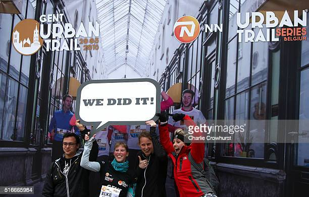 Participants celebrate after taking part in the Urban Trail a running event revolving around a special course which lets the runner experience places...