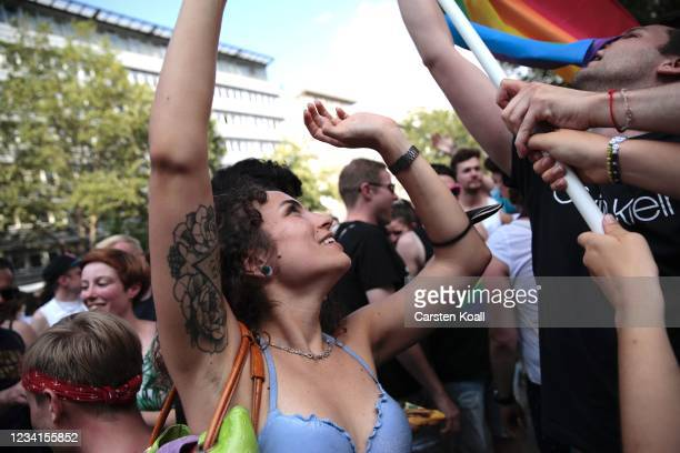 Participants celebrate at the end of the annual Christopher Street Day parade on July 24, 2021 in Berlin, Germany. The Christopher Street Day parade...