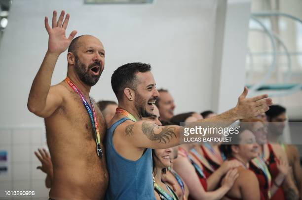 Participants celebrates their medals during the synchronized swimming contest during the 10th edition of the international Gay Games at the Maurice...
