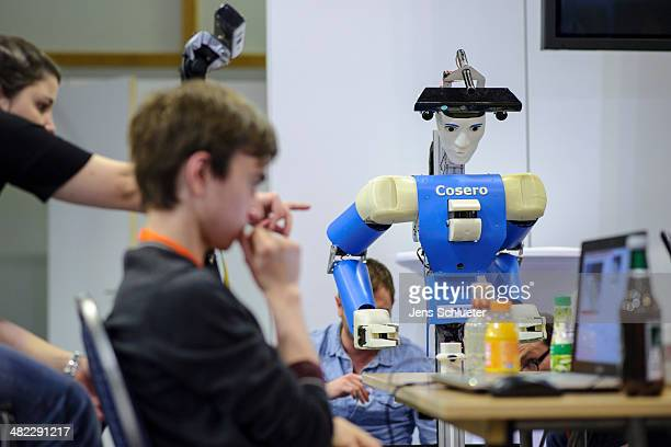 Participants check a service robot at the 2014 RoboCup German Open tournament on April 03 2014 in Magdeburg Germany 950 participants from 12...
