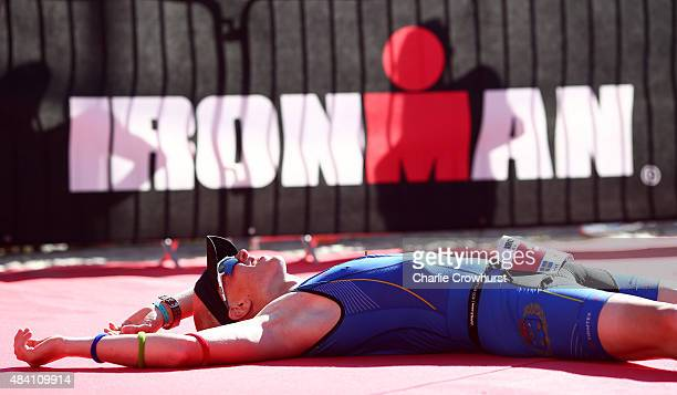 Participants collapse over the line having finished the race during Ironman Kalmar on August 15 2015 in Kalmar Sweden