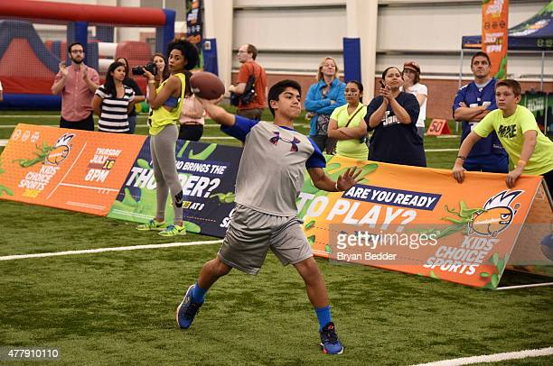 8d3911cea3b Participants compete at Nickelodeon and New York Giants Kids  Choice Sports  2015  Triple Shot