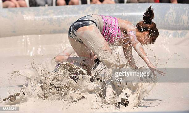 Participants compete during a women's mud wrestling match on May 3 2009 in Wuhan of Hubei Province China About 40 women take part in the mud...