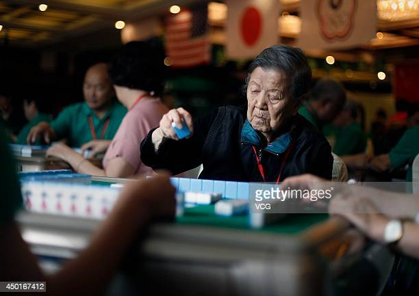 Participants compete during the 2014 World Mahjong Master Invitational Tournament on June 6 2014 in Kunming Yunnan Province of China 143 participants...