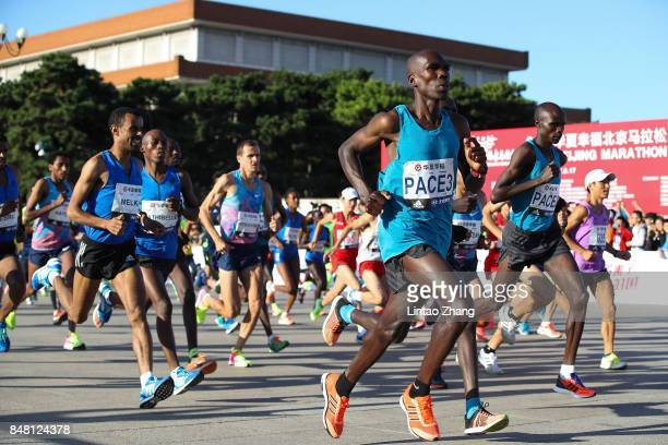 Participants compete during the 2017 Beijing Marathon at Tiananmen Square on September 17 2017 in Beijing China