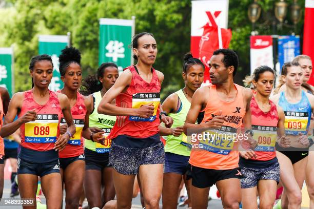Participants compete during the 2018 Dongfeng Renault Wuhan Marathon on April 15 2018 in Wuhan Hubei Province of China