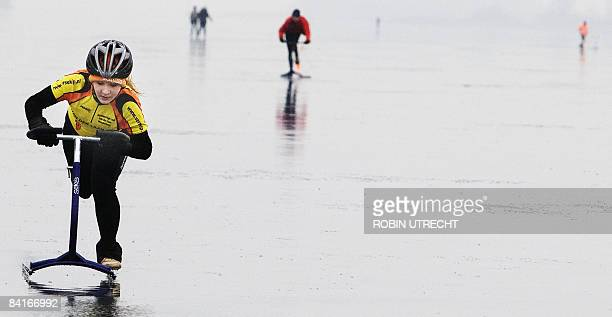 Participants compete during the National stepsledge Championship at Veluwe lake in Elburg the Netherlands on January 4 2009 A stepsledge has two long...