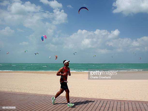 Participants compete during the run leg of the race during the Challenge Triathlon Dubai on 27 February 2015 in Dubai United Arab Emirates