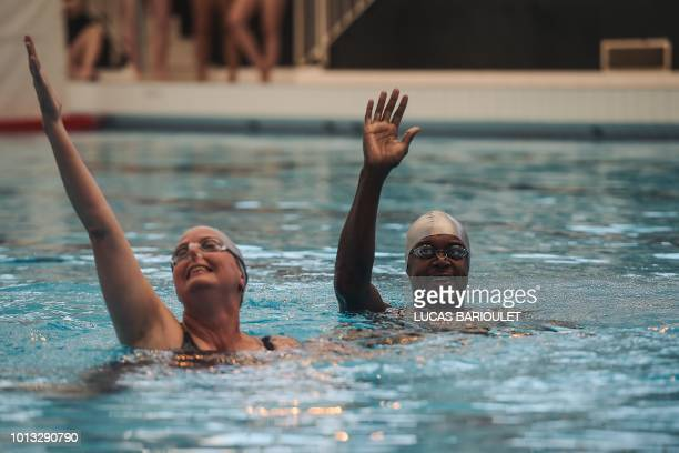 Participants compete during the synchronized swimming contest during the 10th edition of the international Gay Games at the Maurice Thorez swimming...