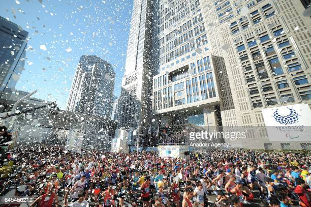Participants compete during the Tokyo Marathon 2017 in front of the Tokyo Metropolitan Government Building in Tokyo Japan on February 26 2017