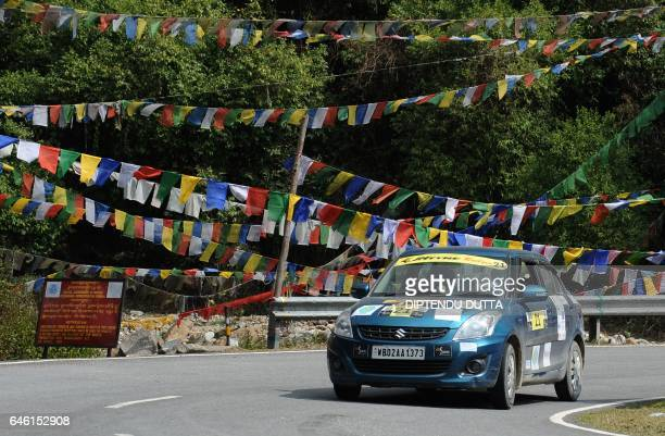 Participants compete during the Tri Nation Himalayan Drive car rally on the way up to Darjeeling India from Paro in Bhutan on February 28 2017 Some...