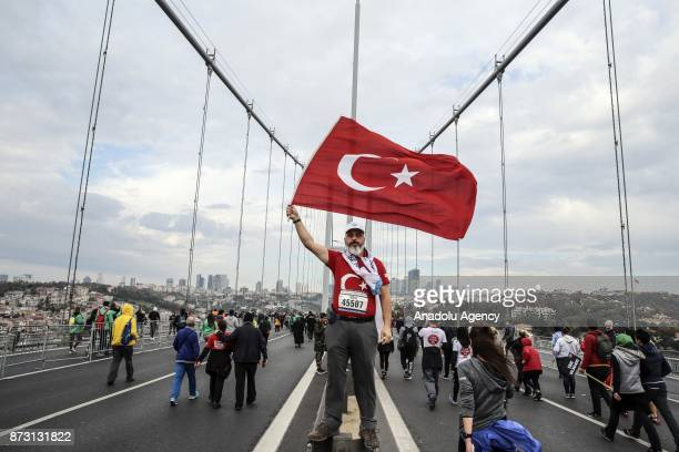 Participants compete during Vodafone 39th Istanbul Marathon at The 15 July Martyrs Bridge in Istanbul Turkey on November 12 2017 It is the only...