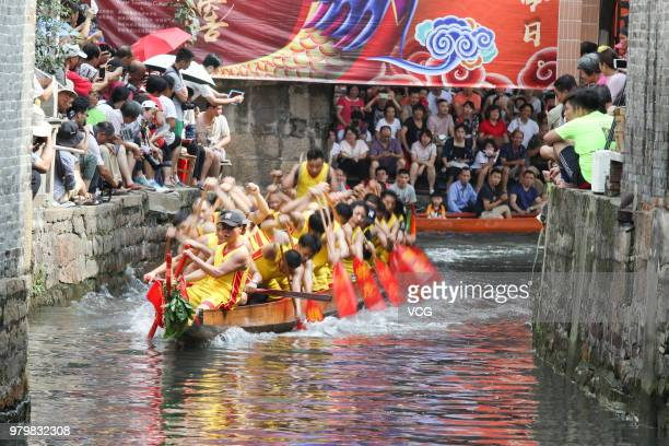 Participants compete in a dragon boat race at Diejiao water village to celebrate the Dragon Boat Festival on June 20 2018 in Foshan China The Dragon...