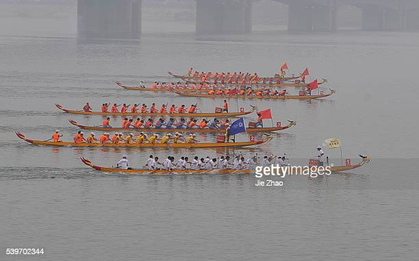 Participants compete in a dragon boat race to celebrate the Dragon Boat Festival in Xiangfan Hubei province June 16 2010 The festival commemorates...