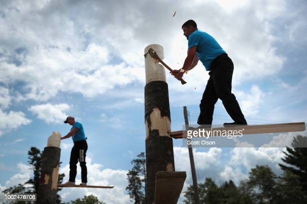 A participant puts on safety gear befoe the start of competition at the Lumberjack World Championships on July 19 2018 in Hayward Wisconsin The event...