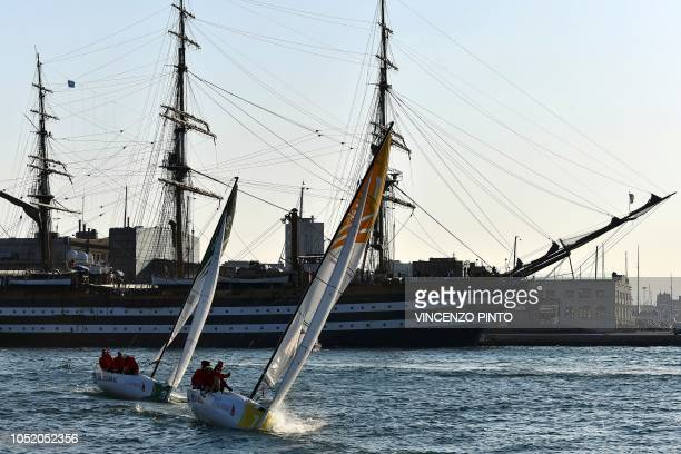 Participants compete in front of the Italian military vessel Amerigo Vespucci during the 'Barcolana Meteor' category as part of the 50th Barcolana...