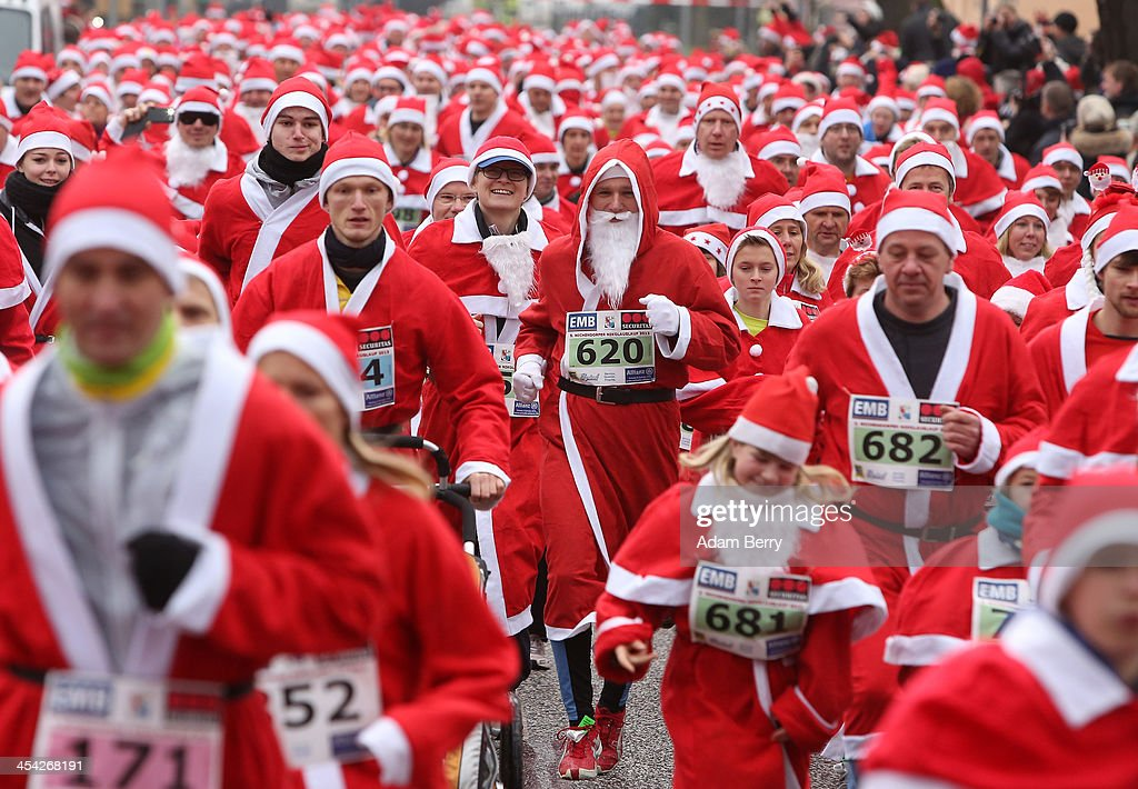 Participants compete in the 5th annual Michendorf Santa Run (Michendorfer Nikolauslauf) on December 8, 2013 in Michendorf, Germany. Over 900 people took part in this year's races, which included one for children and one for adults.