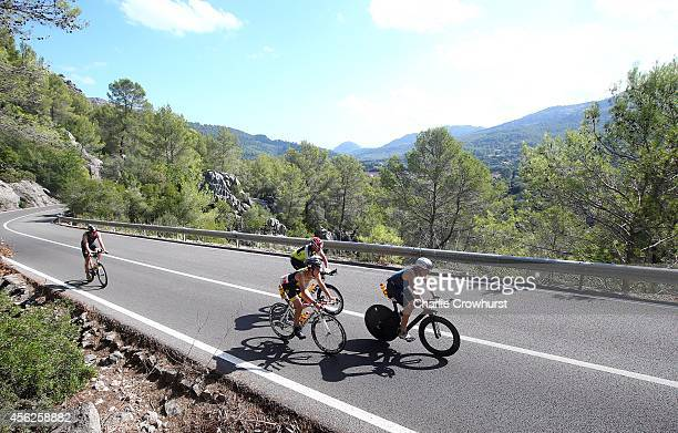 Participants compete in the cycle leg of the race during Ironman Mallorca on September 27 2014 in Palma de Mallorca Spain