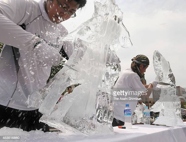 Participants compete in the Ice Sculpture competition at Mojiko Retro area on August 11 2014 in Kitakyushu Fukuoka Japan 18 competitors from Kyushu...
