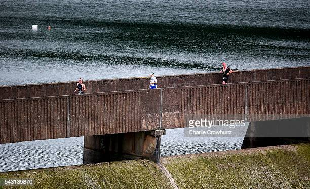 Participants compete in the run leg during the Ironman 703 UK at Exmoor National Park on June 26 2016 in Somerset England