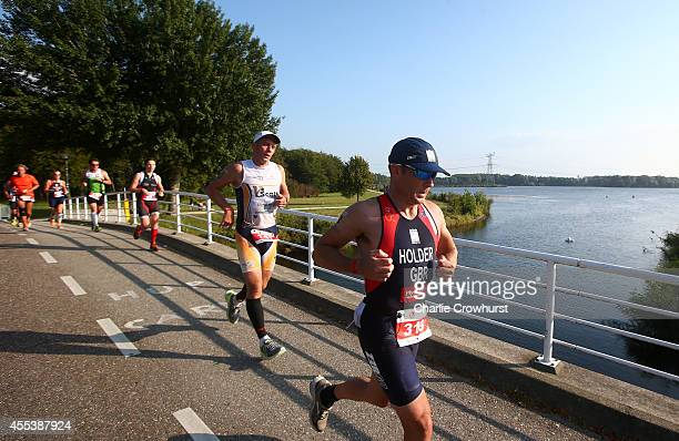 Participants compete in the run leg of the race during The Challenge Triathlon AlmereAmsterdam on September 13 2014 in Almere Netherlands