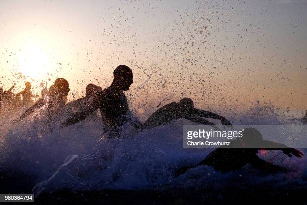 Participants compete in the swim leg of the race during IRONMAN 703 Barcelona on May 20 2018 in Barcelona Spain